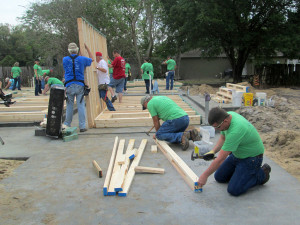 Peoples Gas team members building walls for a Habitat home