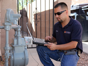 Henry Jaramillo Jr. checks a customer's meter in New Mexico.